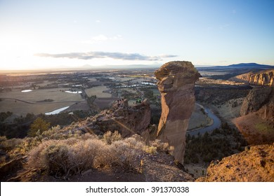 SMITH ROCK, OR - FEBRUARY 22, 2016: Group of rock climbers come together at the back of the Monkey Face monolith at Smith Rock State Park in Central Oregon.