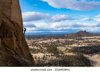 Smith Rock State Park in Oregon. Climber ascending up Monkey Face.