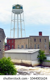 Smiths Falls, ON, Canada - June 14, 2015: The town of Smiths Falls with its Water Tower on the Rideau River is experiencing an economic recovery due to the arrival of cannabis producer Canopy Growth