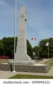 SMITHS FALLS, ONTARIO, CA, JUNE 12, 2021: A Canadian War Memorial site with the flags at half mass located in Smiths Falls, Ontario.