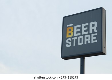 SMITHS FALLS, ONTARIO, CANADA, MARCH 10, 2021: Closeup view of The Beer Store sign located in the small town of Smiths Falls, ON, during the late winter season.