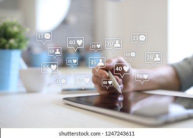 SMM, likes, followers and message icons on virtual screen. Social media marketing. Business and internet concept.