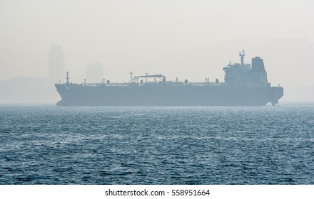 Smog in the city with foggy weather ship in foreground