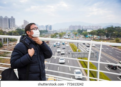Smog in the city.men in medical mask with sore throat