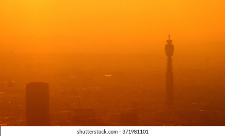 Smog covers London skyline at sunset