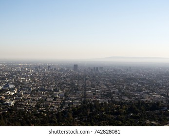 Smog and foggy in Los Angeles County, California. Top view, clear day, blue sky.