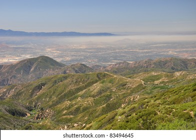 Smog hangs over the city of San Bernardino, California. Photographed from the Rim of the World highway.