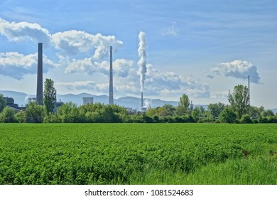Smog hell - sunny day. View factory chimney with lots of smoke and smog. Europe, landscape Slovakia, Novaky. Chemical factory. Abstract. Global warming of the earth.