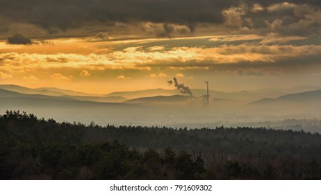 Smog hell - sunset. View from afar the city and a factory chimney with lots of smoke and smog. Europe, landscape Slovakia, Novaky. Chemical factory. Abstract. Global warming of the earth.