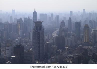 Smog lies over the skyline of Shanghai, China