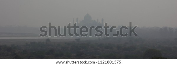 Smog obscured view of Taj Mahal