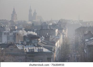 Smog over Krakow, Cracow. Poland. Europe. Cityscape with Mariacki church, St. Mary's Basilica.