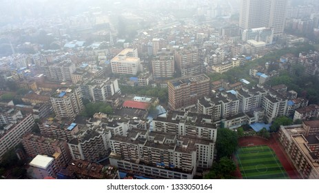 Smog in Residential Area in Guangzhou China Overlooking Soccer Field and Track Complex