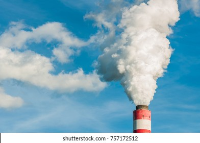 Smog of smoke combustion coming out of a chimney in city