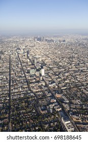 Smoggy summer afternoon aerial view of the Wilshire Blvd and downtown Los Angeles in Southern California.