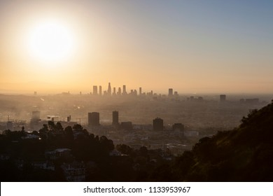 Smoggy sunrise hilltop view towards Hollywood and Downtown Los Angeles.