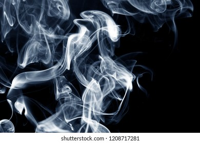 Smoke abstract as background / Smoke is a collection of airborne solid and liquid particulates and gases emitted when a material undergoes combustion or pyrolysis