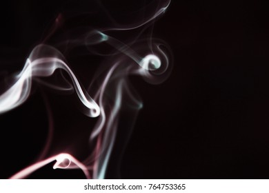 Smoke abstract as background / Smoke is a collection of airborne solid and liquid particulates and gases emitted when a material undergoes combustion