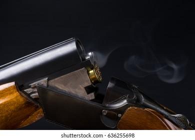 the smoke after firing a shotgun on a black background