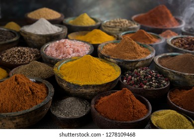 Smoke, Aromatic spices on wooden background