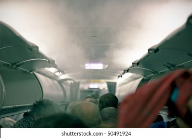 smoke in the cabin of passenger aircraft photo