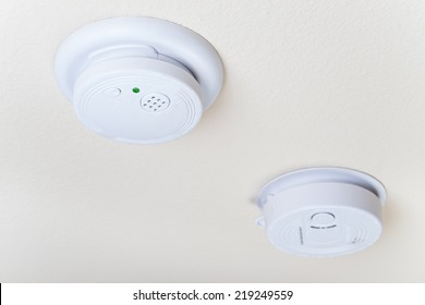 Smoke and a carbon monoxide alarm mounted on the ceiling