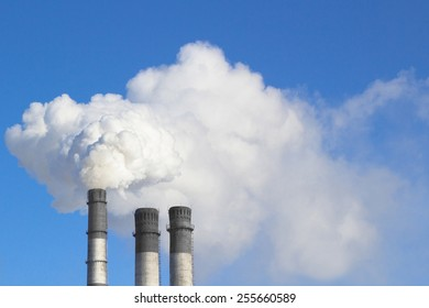 The smoke from the chimneys