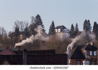 smoke of chimneys at historical buildings at eastern springtime in south germany