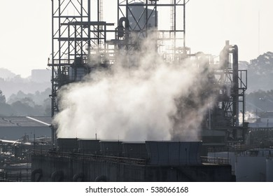 smoke from chimneys . Utility plant, Oil Refinery in Thailand .