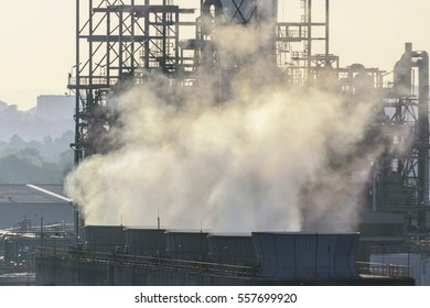 smoke from chimneys . Utility plant at Oil Refinery industry . pollution concept .