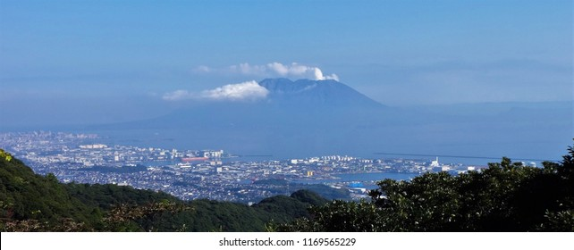 Smoke coming from an active volcano Sakurajima and City of Kagoshima from a viewpoint