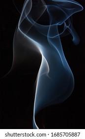 Smoke dancing in the dark