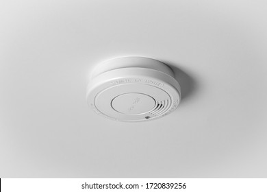 Smoke detector on the white ceiling. Stay home safe. Home control and security.  Smoke detector