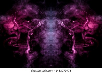 Smoke of different blue, red and pink colors in form of horror in the shape of the head, face and eye with wings on a black isolated background. Soul and ghost in mystical symbol. Print for clothes.