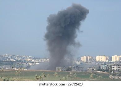 smoke of explosion in Gaza. morning light.