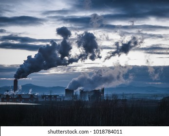 Smoke from the factory pipes. Ecological problem, mining enterprise with smoke stacks. Dirty smoke on the sky. Environmental issues. harmful emissions. Bad ecology.