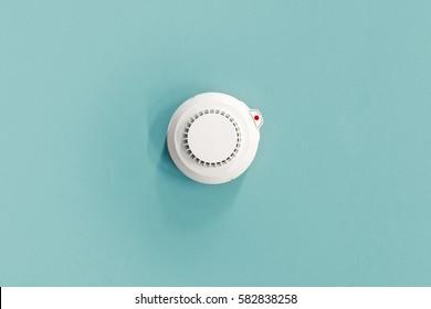 Smoke fire detected Smoke detector on light blue ceiling