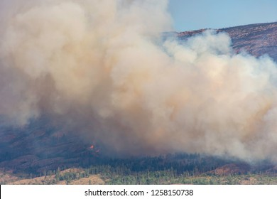 Smoke from a forest fire near Pearchland British Columbia Canada