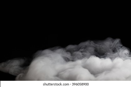 Smoke fragments on a black background with copy space