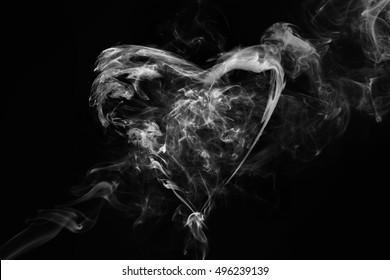 Smoke heart shape in the dark.