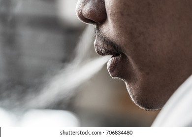 Smoke from his mouth / Smoke his mouth, gently dripping / smeared.