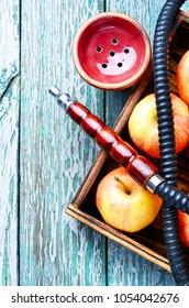 Smoke hookah with apple.Shisha concept.Hookah concept.Fruit hookah