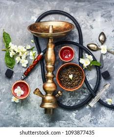 Smoke hookah with jasmine floral scent.Shisha concept.Modern hookah