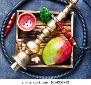 Smoke hookah with with mango.Shisha concept.Hookah concept