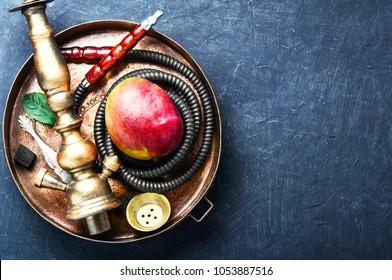 Smoke hookah with with mango.Shisha concept.Hookah concept.Shisha for relax