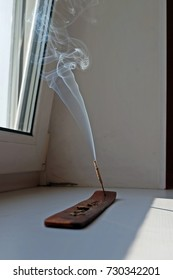 The smoke from the incense stick.