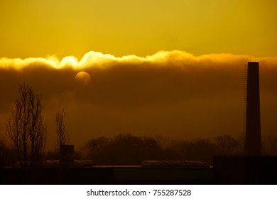Smoke from industrial chimneys at dawn