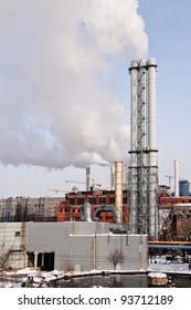 Smoke from industrial plant in city center. Kiev, Ukraine.