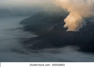 Smoke from inside the Bromo volcano in Bromo tengger semeru national park, East Java, Indonesia
