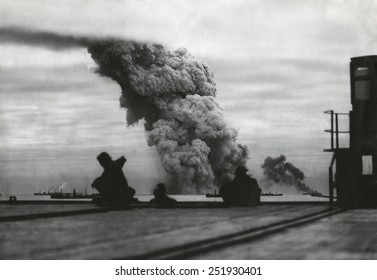Smoke from a merchant ship bombed in an Allied convoy to the Soviet Union (Russia).October 1942.